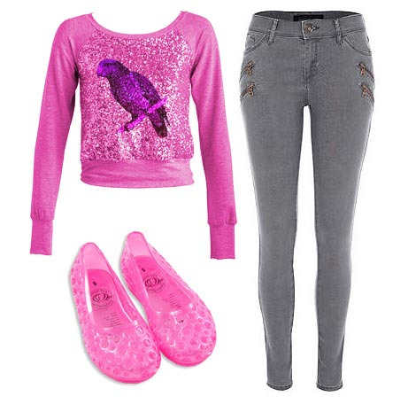 Stacey McGill pink sweatshirt sequins large purple parrot, short, tight-fitting jeans zippers up the outsides, pink plastic shoes.