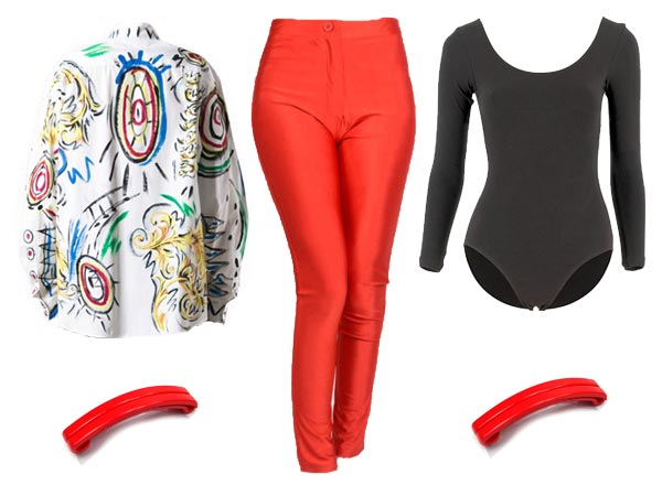 Claudia Kishi wearing black leotard, skintight red pants, white shirt lab coat decorated with designs painted in acrylic, red hair clips.