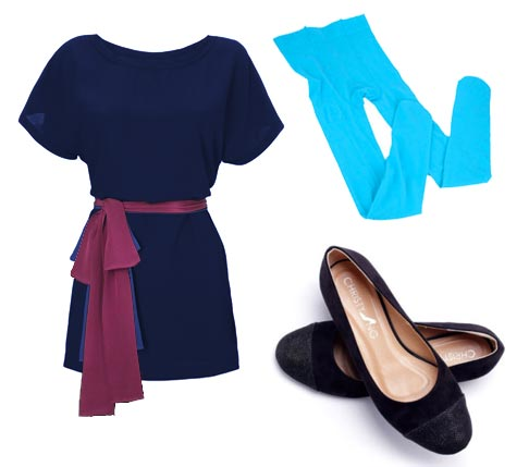 Mary Anne wearing navy blue minidress, pink sash, blue tights, black slippers