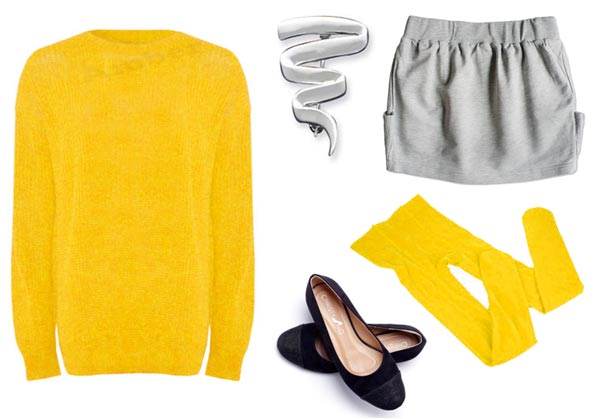 Mary Anne Spier wearing yellow sweater grey sweat skirt yellow tights silver squiggle pin and ballet slippers
