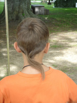 Kid with a rat's tail